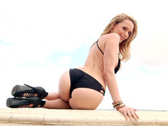 Classy babe Mia Malkova slowly shows off her body poolside