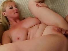 Busty grandma sucking huge cock and getting fucked