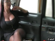 Redhead with massive tits banged in a fake taxi