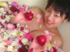 Romantic Asian chick Megumi Kagurazaka takes a bath with rose petals