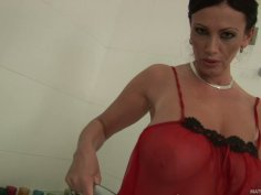 Bosomy brunette cougar Pandora washes her huge boobs