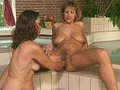 Two hairy lesbian milfs fisting