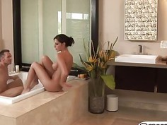 Oiled Brunette With Large Tits Bounces On Hard Dick
