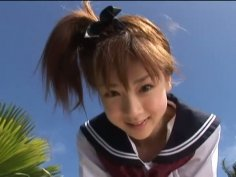 Japanese teen Aki Hoshino plays outside in the sailor outfit