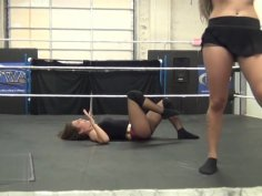 2 girls wrestling in socks