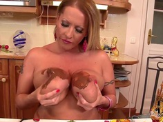 Mature milf Laura M. plays with tits and food