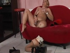 Weird blonde lesbian licking her hairy pussy